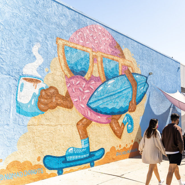 Nomad donut surfing and skateboarding mural in North Park, San Diego